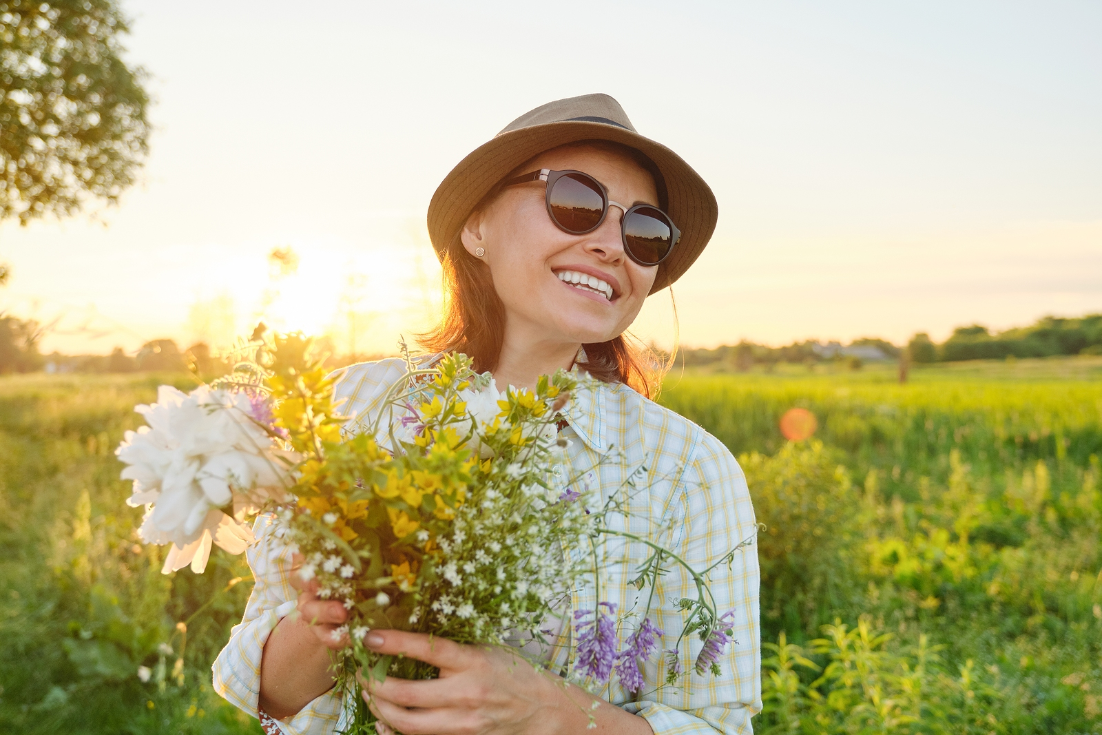 Outdoor Portrait Of Mature Happy Smiling Woman