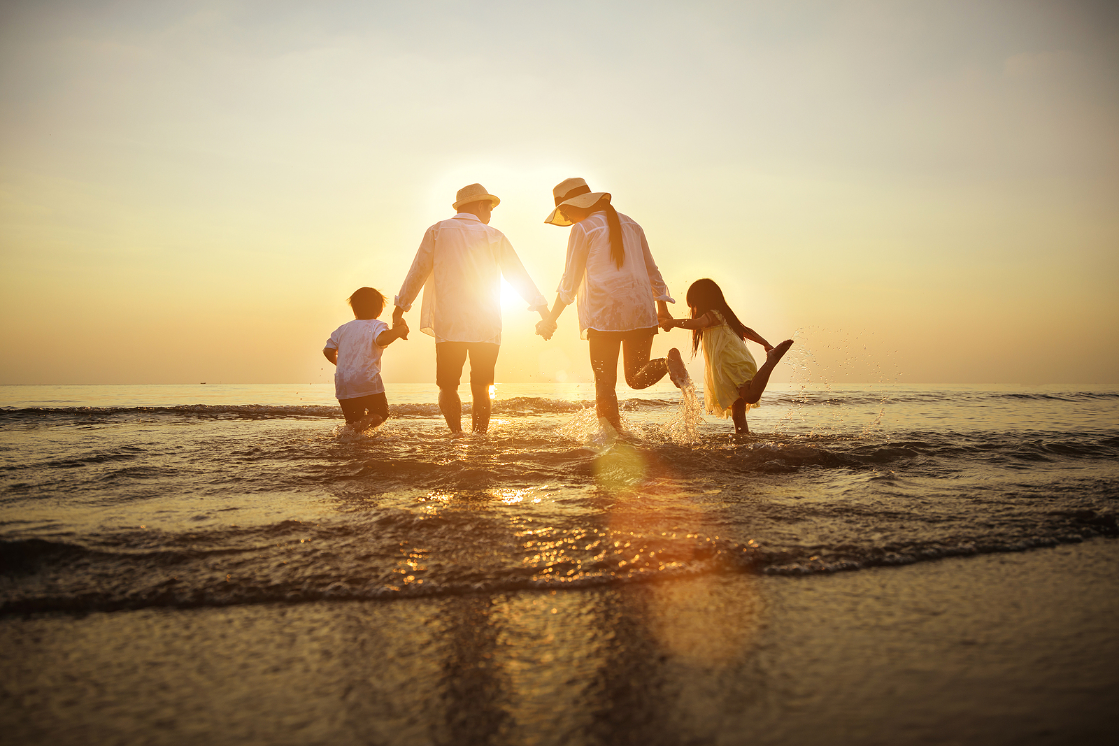Summer Vacations. Happy Family Is Holding Hands Running